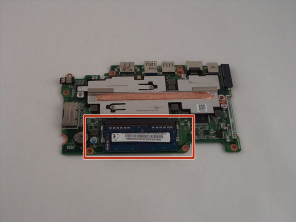 Once the motherboard has been removed from the device, flip the motherboard over to reveal the RAM chip.