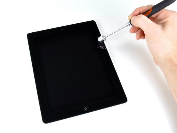 Image 3/3: In fact, you don't need the Smart Cover to turn your iPad 2's screen on or off. We used iFixit's handy-dandy [product|IF145-078|magnetic pickup tool] to activate the sleep sensor on the iPad 2.