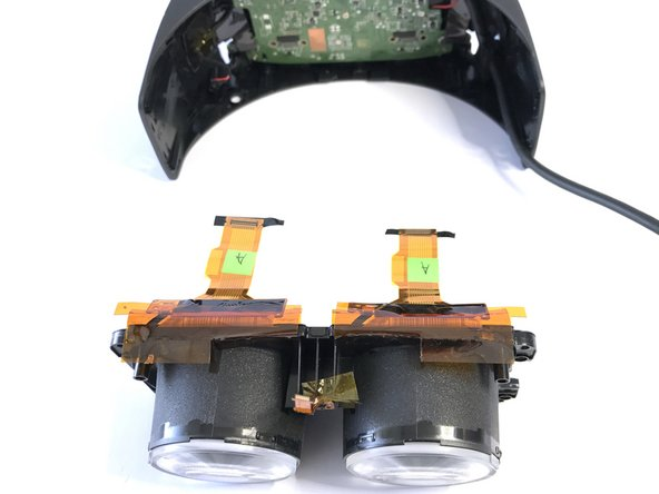 With the lenses removed, you can begin separating the PCB from whats left of the HMD.