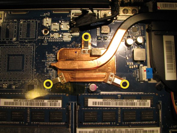 Image 1/3: Lift up the heat sink from the motherboard and remove it.