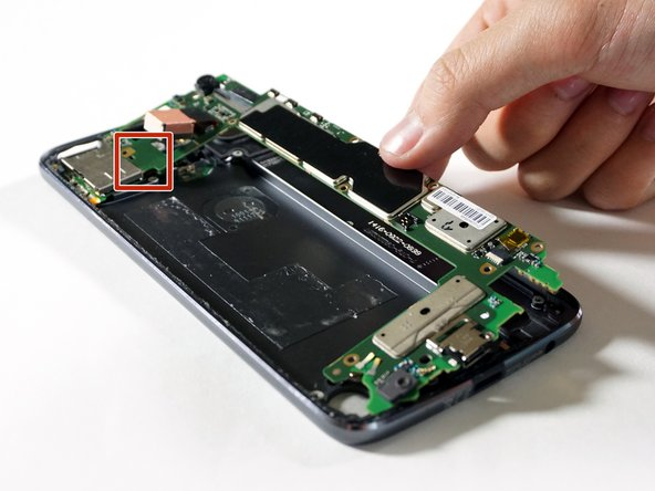 Lift the motherboard from the right edge like a book towards the left.