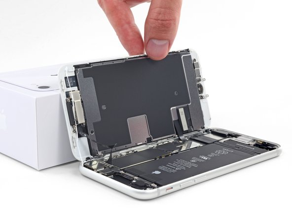 Lean the display against something to keep it propped up while you're working on the phone.
