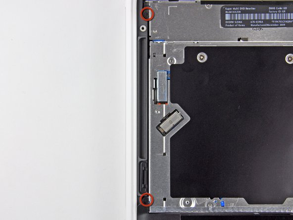 Remove the two 2.5 mm Phillips screws securing the optical drive to the upper case near the optical drive opening.