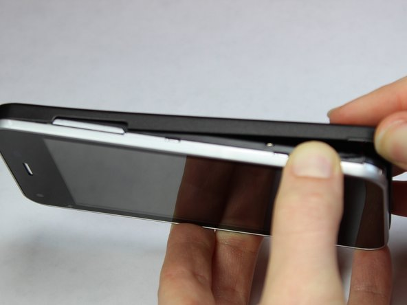 Gently remove the back case completely from the phone.