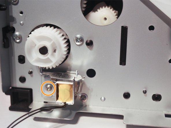 Image 3/3: Remove 1 screw to remove the third solenoid.