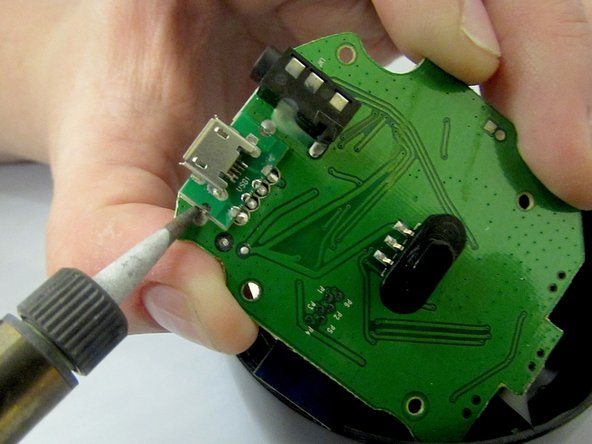 Using a soldering tool desolder the charging port from the motherboard.