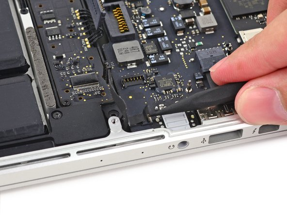 Image 2/3: Pull the microphone cable out of its socket on the logic board.