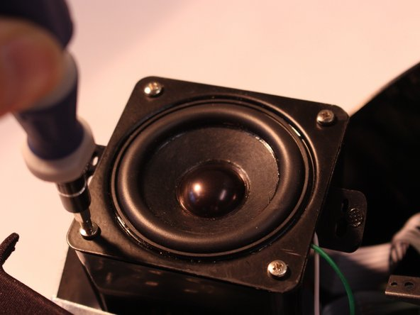 Remove four 7mm screws to detach speaker from speaker assembly