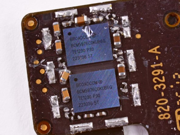 Image 2/2: Hiding on the connector are a couple of Broadcom touch controller ICs marked [https://chipworks.secure.force.com/catalog/ProductDetails?sku=BRO-BCM5976A0KUB2G|BCM5976C0KUB6G].