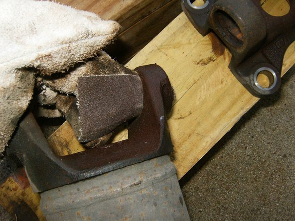 Clean the bearing openings with either a piece of emery cloth or a file. Deburr all the edges