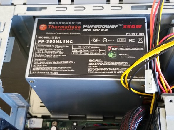 Remove the power supply by pushing it out from the back of the computer and lifting it out of the computer.