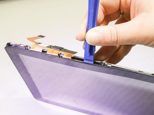 Use a plastic opening tool to gradually separate the screen from the device.