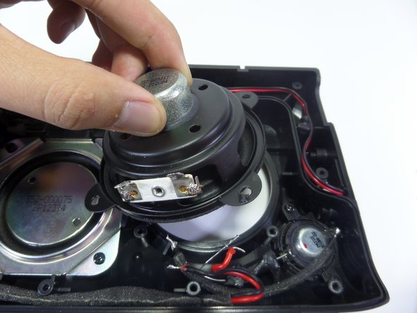 Lift the speaker out of the device using your fingers.