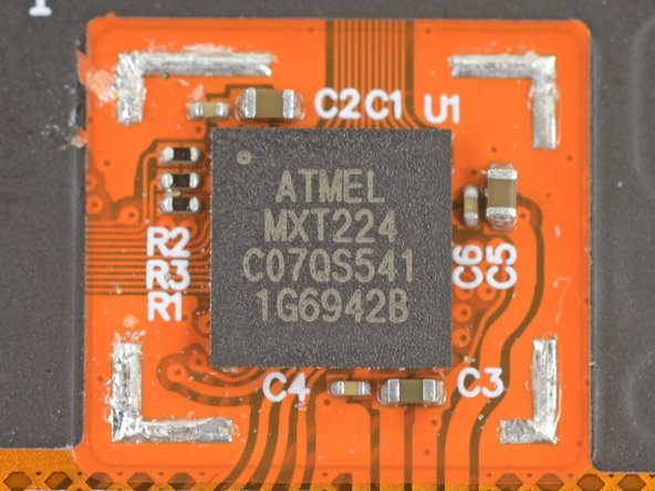 Underneath we find another Atmel mXT224 touchscreen controller, which has graced tons of teardown devices in the past, including this one!