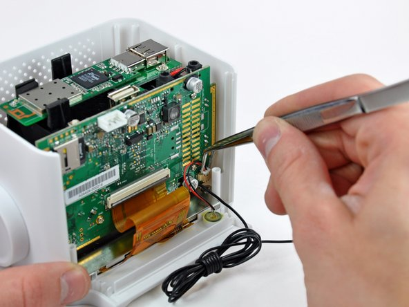 Use a pair of tweezers to pull the microphone connector away from the front of the chumby.