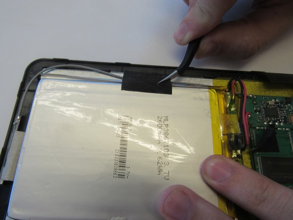 Remove the two black tape strips from the battery pack.