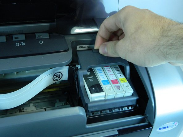 Image 2/3: Open the printer and move the carriage with the ink cartridges to the left so you have access to them.