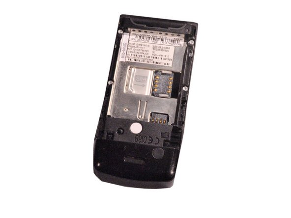 Turn over the phone to the back side of phone where the battery was removed.