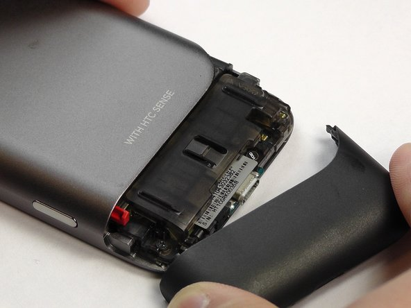 Apply pressure to the dark plastic casing and slide the casing downward, off of the phone.