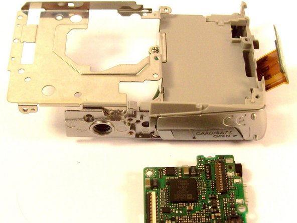 Once the screw is removed, gently lift the motherboard away from the case.