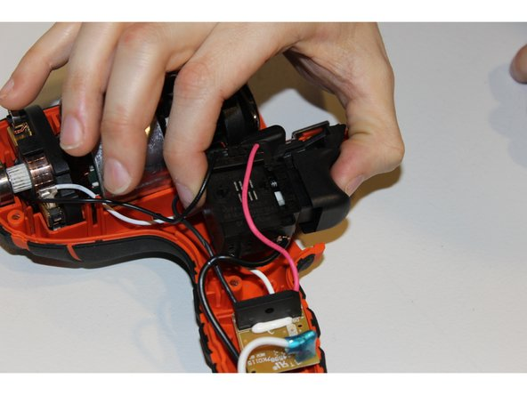 Physically pull up on the trigger device and remove it from the armature.