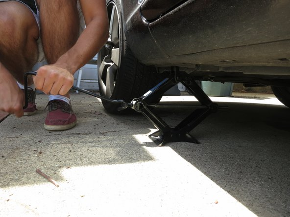 It's best to avoid using the jack included with the car. If at all possible, use at least a 2 ton floor jack.