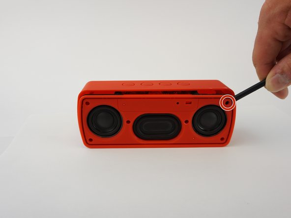 Image 1/1: The screw on the upper right corner may be difficult to take out. If you cannot take it out with a screwdriver, using force to pull the face of the speaker apart may break the plastic that surrounds the screw.