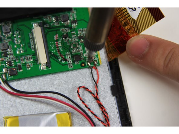 Desolder the red and black wires on the right side of the motherboard that connect the speaker to the motherboard.