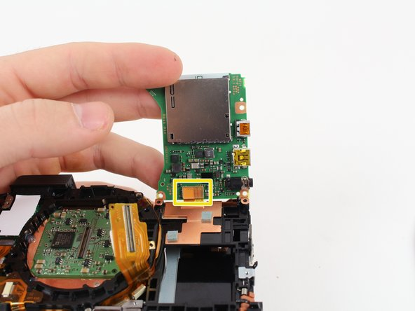 Image 3/3: Carefully rotate the motherboard upward.