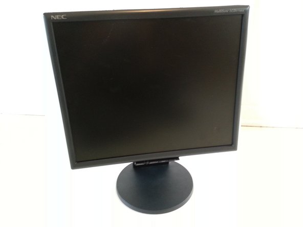 Place the monitor face down on a clean, flat surface.