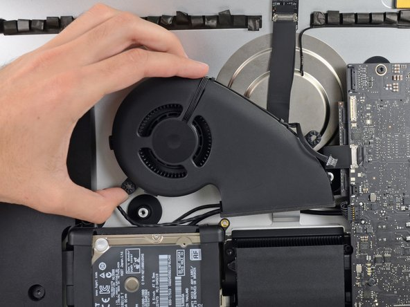 Lift and remove the fan from the iMac.