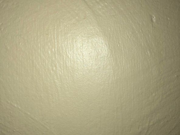 Use paint that matches the rest of the wall for best results.