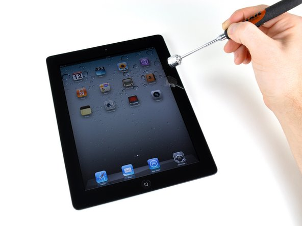 Image 2/3: The Smart Cover has one magnet that turns off the iPad 2's screen. The rest are used to either clamp to the iPad on the right side (the far-right column of magnets), or to form the triangular shape used to create a stand for the iPad 2.