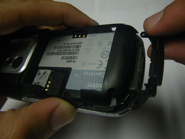 Remove the small plastic insert at the bottom of the phone.