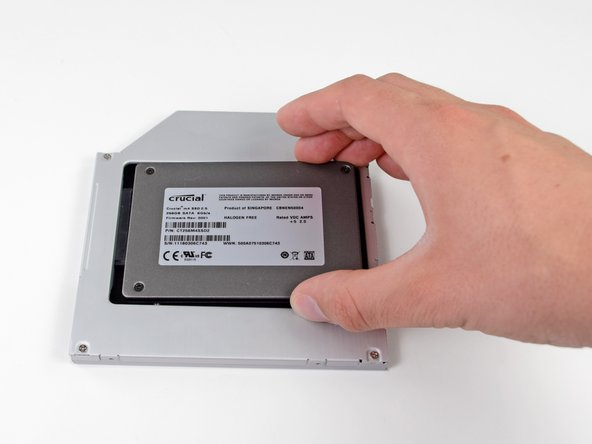 Gently place the hard drive into the enclosure's hard drive slot.