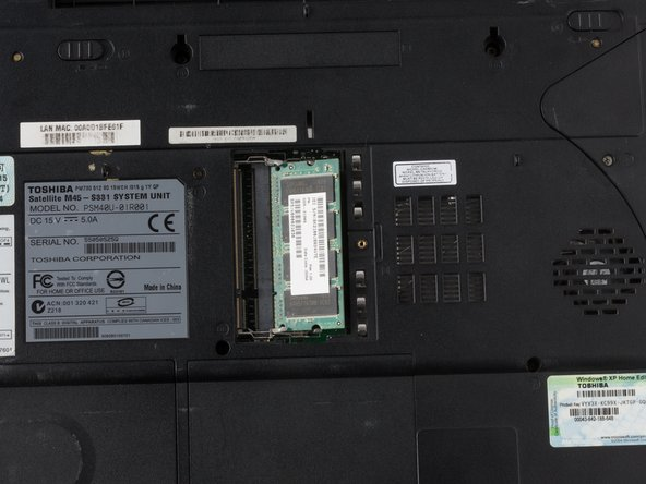 Use a #1 Phillips head screwdriver to remove the screws on the RAM's cover panel, as seen in image.