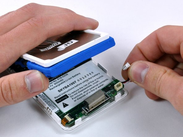 Use one hand to lift the hard drive up in order to access the battery beneath.