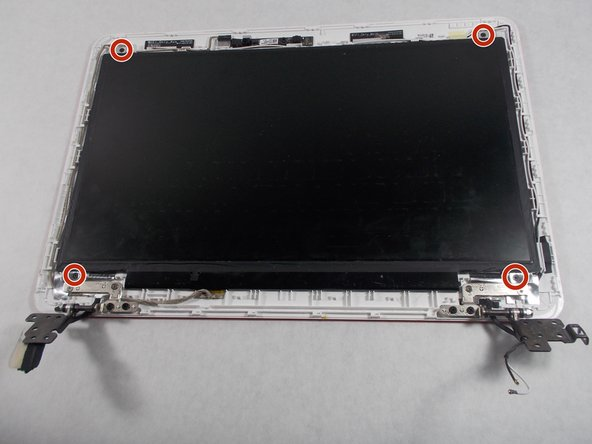 Remove the four 2mm Phillips #0 screws from the four corners of the screen.