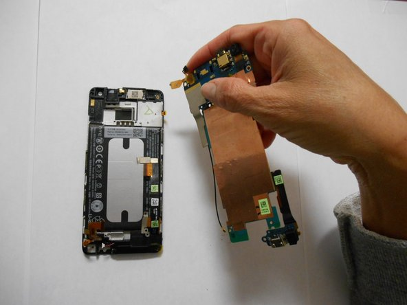 Image 3/3: Remove the motherboard completely.