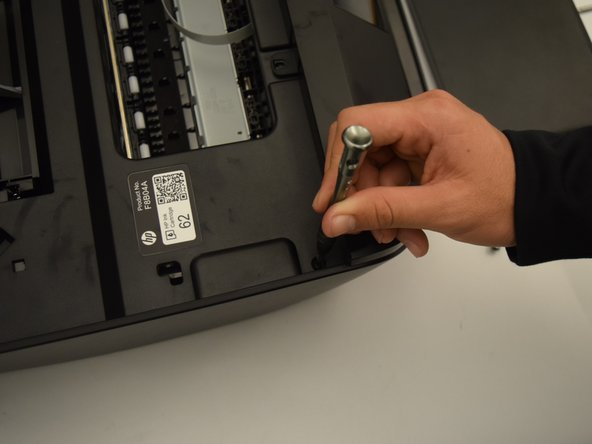 Remove the  12 mm screws on the left side of the printer with a T10 bit.