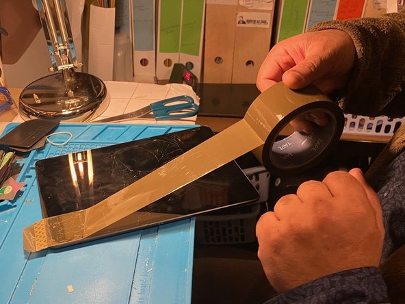 Apply tape to the screen to help avoid any smaller pieces of glass from separating from digitizer during removal.
