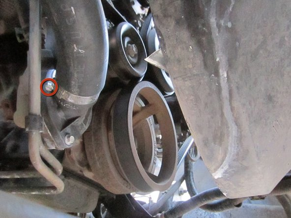 If you need to completely drain the coolant, place a bucket underneath the coolant hose, near the front of the engine.