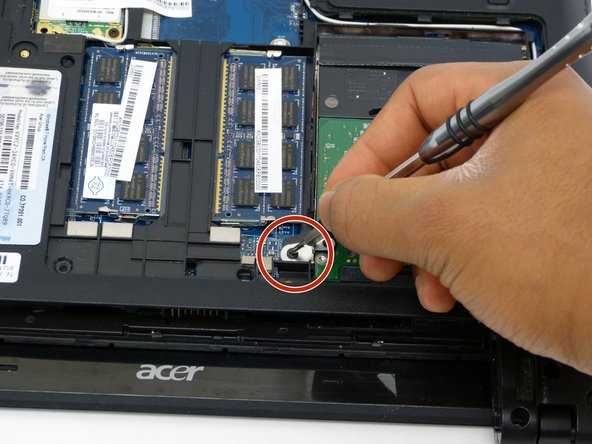Remove screw attached to the hard drive using the PH0 mm Phillips Head.