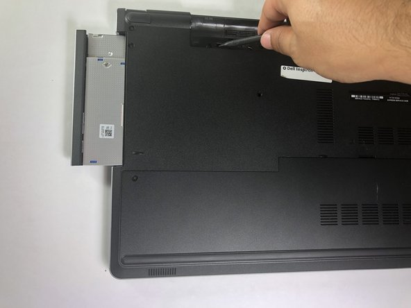 Use your hand to pull the CD drive out while using the spudger as leverage to push the CD drive out.
