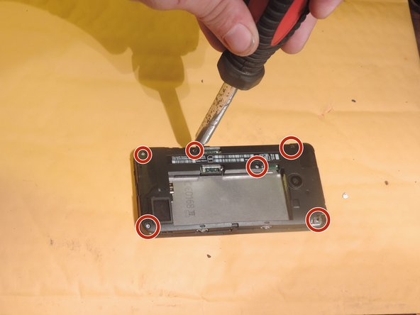 "Remove the six 2.3mm screws with a ""T5"" Screwdriver."