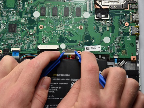 Carefully but firmly, pry the connector from its socket by pulling it towards the battery.