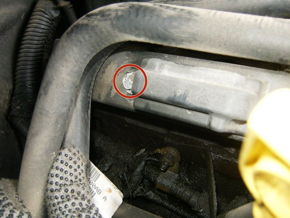 The fourth one is somewhat hidden in the back, under the coolant lines for the heater. The hoses can easily be moved out of the way.