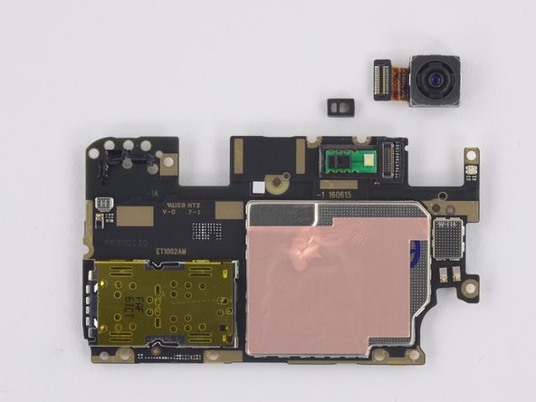 Once the motherboard is removed, the rear-facing camera can be removed. Also the rubber bumper on the flash/proximity sensor portion of the main board.