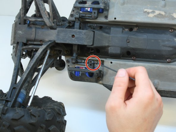 Pull the connecting linkage out of the steering horn.
