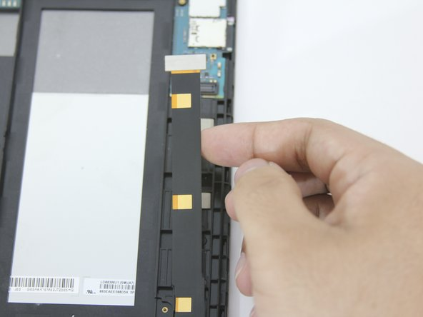 Only lift up the end of the ribbon connector that is attached to the motherboard. The end at the base of the tablet should stay attached.